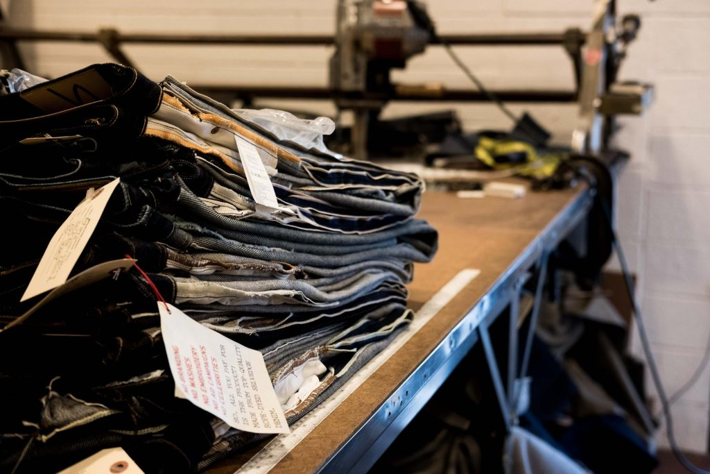 Railcar Fine Goods Stack of Denim Repairs and Alterations
